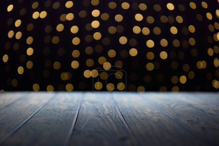 Photo for Empty wooden planks surface and shiny golden bokeh background - Royalty Free Image
