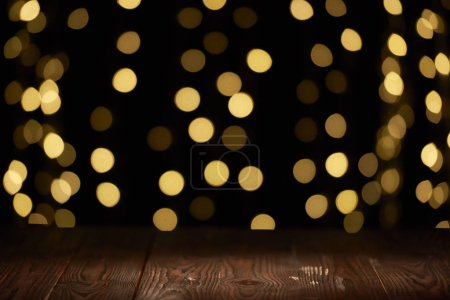 empty wooden planks surface and beautiful shiny bokeh background
