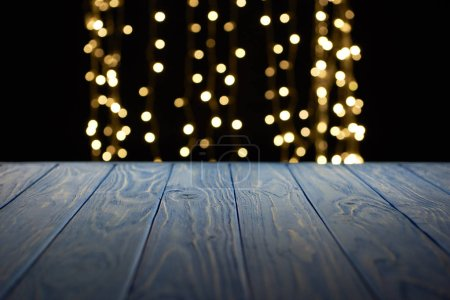 empty wooden surface and beautiful golden lights bokeh background