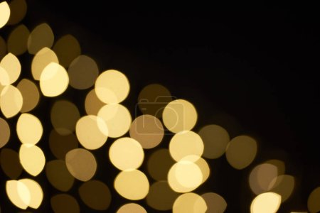 beautiful golden shiny defocused bokeh on black background
