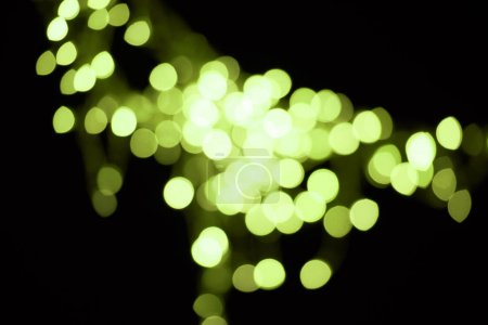beautiful shiny green defocused bokeh on black background