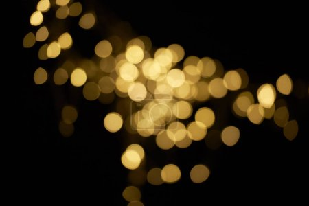 Photo for Beautiful golden defocused bokeh on black background - Royalty Free Image