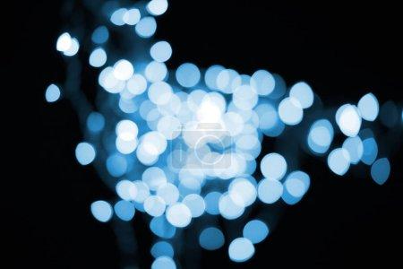 beautiful shiny blue bokeh on black background