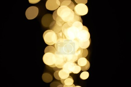 beautiful shiny golden bokeh on black background