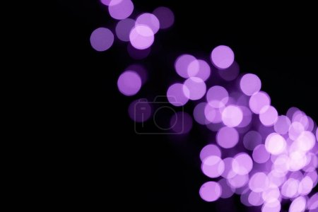 Photo for Beautiful shiny defocused purple bokeh on black background - Royalty Free Image