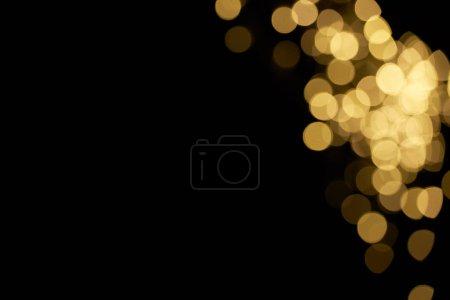 beautiful shiny defocused yellow bokeh on black background