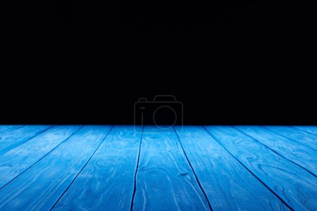 empty light blue wooden planks surface on black background