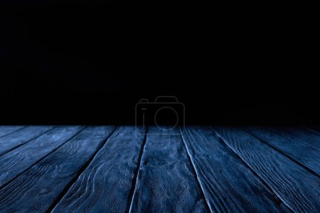 empty dark blue wooden planks surface on black background