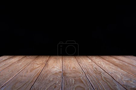 empty brown wooden planks surface on black background