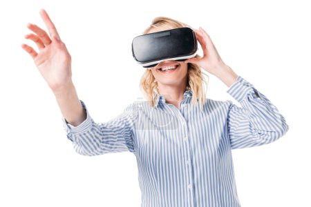 Photo for Smiling attractive woman using virtual reality headset and touching something isolated on white - Royalty Free Image