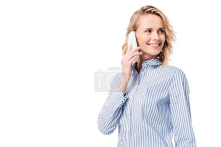 attractive woman talking by smartphone and looking away isolated on white
