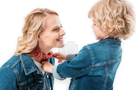 portrait of son playing with mothers headband isolated on white