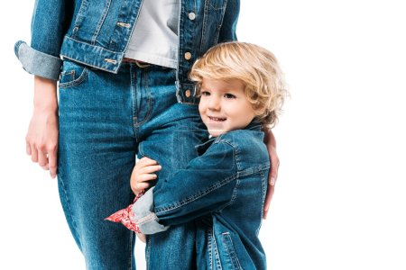 cropped image of son hugging mothers leg isolated on white