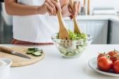 cropped shot of woman preparing delicious healthy salad