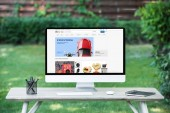 selective focus of computer with ebay website at table outdoors