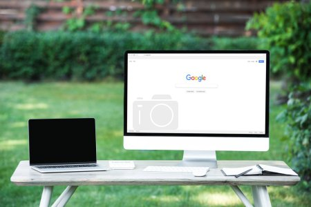 Photo for Selective focus of laptop with blank screen computer with google website at table outdoors - Royalty Free Image