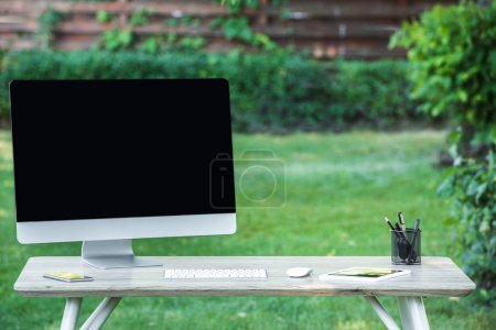 Photo for Selective focus of smartphone, digital tablet and computer with blank screen at table outdoors - Royalty Free Image