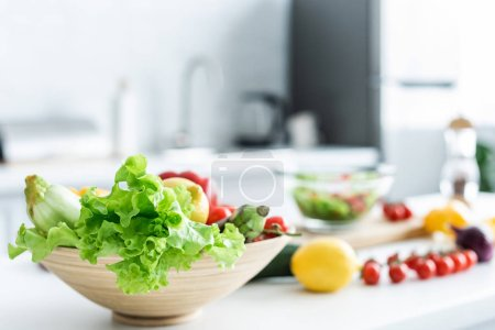 Photo for Close-up view of bowl with fresh healthy vegetables on kitchen table - Royalty Free Image