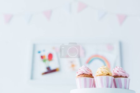 selective focus of delicious cupcakes on stand