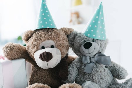selective focus of teddy bears in cones and gift box
