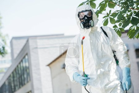 Photo for Low angle view of pest control worker standing with sprayer - Royalty Free Image