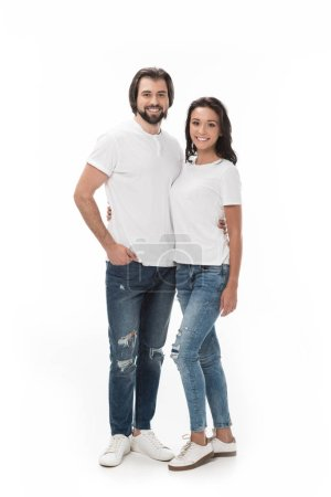 smiling couple hugging and looking at camera isolated on white