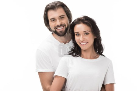 portrait of smiling couple looking at camera isolated on white