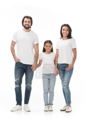 Photo for Smiling family in white shirts holding hands and looking at camera isolated on white - Royalty Free Image