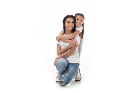 Photo for Happy daughter hugging mother and looking at camera isolated on white - Royalty Free Image