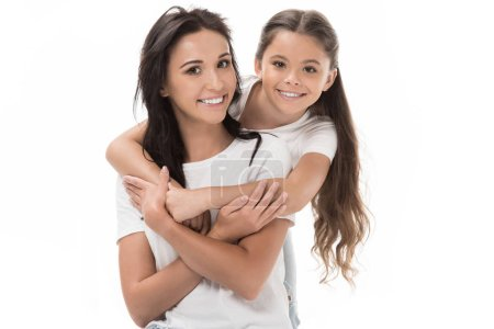 portrait of happy daughter hugging mother isolated on white