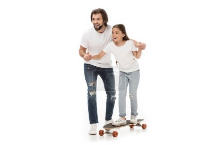 father helping little daughter skating on skateboard isolated on white