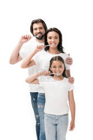 portrait of smiling family in white shirts with toothbrushes isolated on white