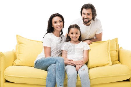 portrait of cheerful family in white shirts on yellow sofa isolated on white
