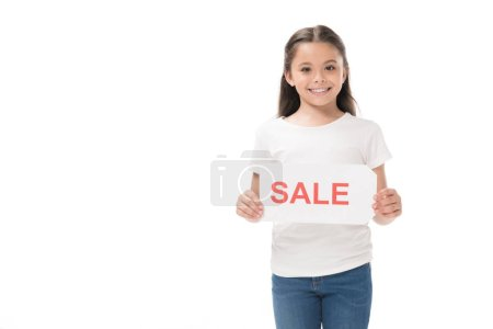 portrait of smiling kid with sale banner in hands isolated on white