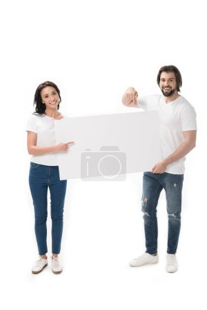 smiling couple pointing at blank banner isolated on white