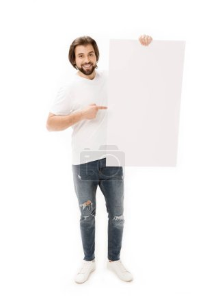 smiling bearded man pointing at blank banner in hand isolated on white