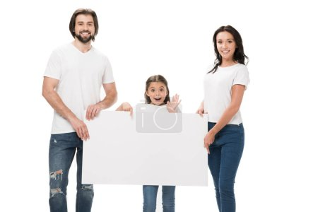 smiling parents and excited daughter with blank banner isolated on white