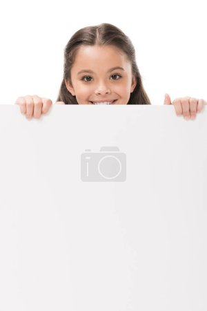 smiling child with blank banner in hands looking at camera isolated on white