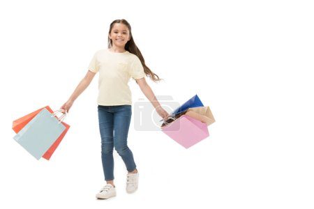 smiling kid with shopping bags isolated on white