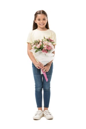 smiling kid with bouquet of flowers looking at camera isolated on white