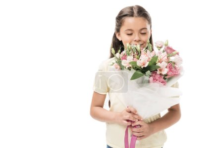 portrait of kid with eyes closed and bouquet of flowers isolated on white
