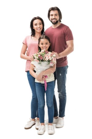 smiling daughter with bouquet of flowers with parents behind isolated on white