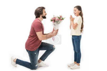 Photo for Side view of father presenting bouquet of flowers to little daughter isolated on white - Royalty Free Image