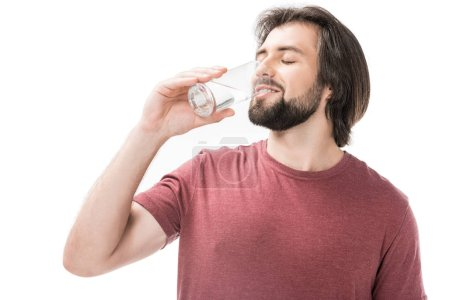 Photo for Portrait of bearded man with eyes closed drinking water from glass in hand isolated on white - Royalty Free Image