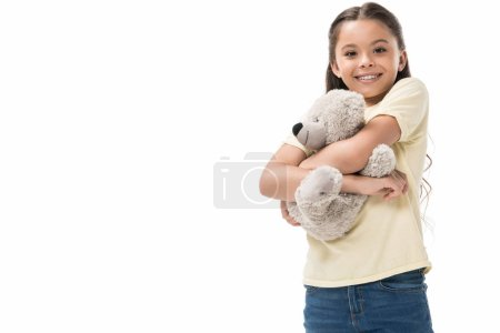 portrait of cute smiling kid hugging teddy bear isolated on white