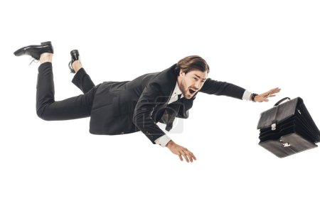 frightened young businessman falling with briefcase isolated on white
