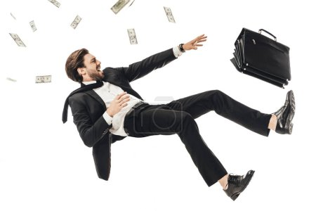 Photo for Shouting young businessman falling with money and briefcase isolated on white - Royalty Free Image