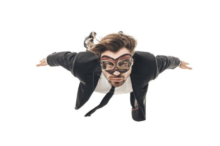 attractive young businessman in vintage aviation goggles falling isolated on white