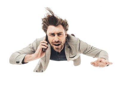 Photo pour Beau jeune homme d'affaires parler par téléphone alors qu'il est tomber isolé sur blanc - image libre de droit