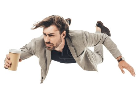 handsome young businessman in suit falling isolated on white